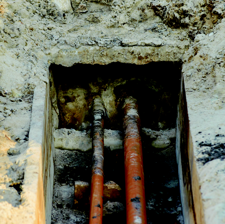 Two buried pipes underground