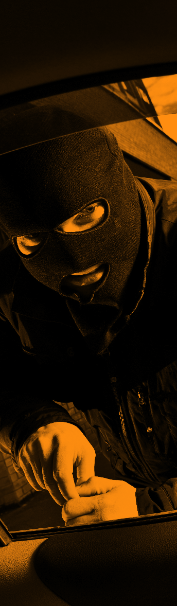 Man with ski mask on looking in car window