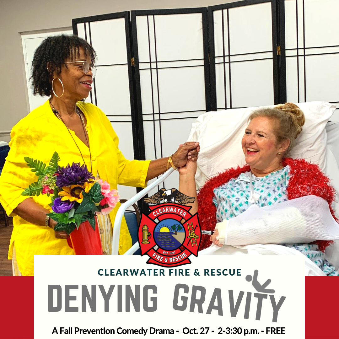 Woman holding another woman's hand. Denying Gravity Oct. 27, A Fall Prevention Play, 2-3:30 p.m.