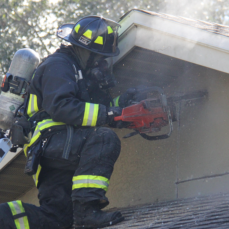 Firefighter Sawing Roof