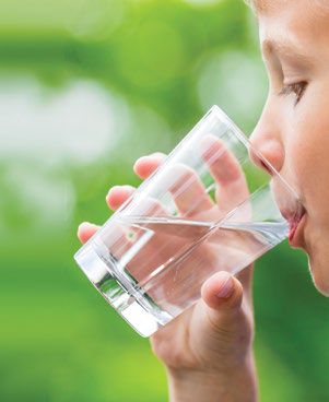 Boy drinking water out of a cup